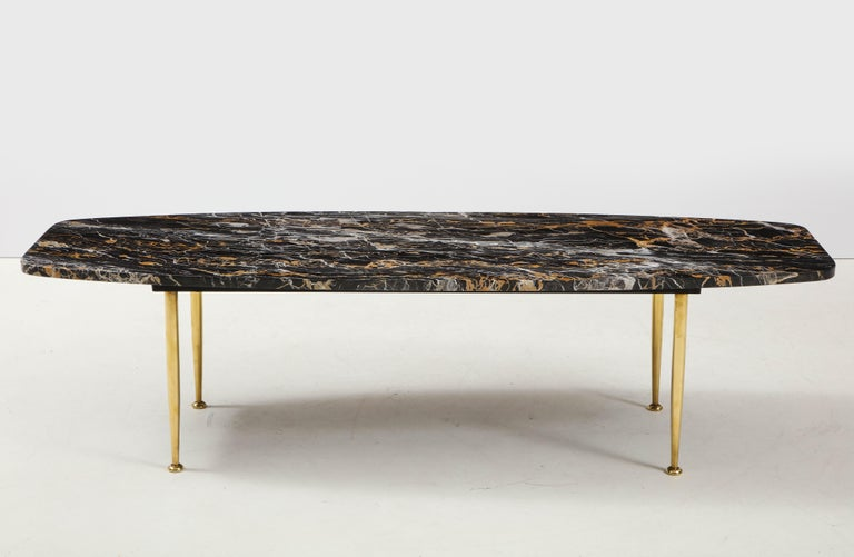 Stunning 1950s Mid-Century Modern exotic marble top with tapered brass legs Italian coffee table. In vintage condition the legs have been lightly hand polished.