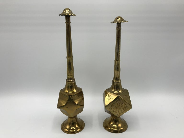 Listed is a stunning, 1950s Moroccan brass salt and pepper shaker set. The pair is unlike any other we've seen before. The geometric bodies, hand-etched floral motifs all-over, and the long-stemmed necks are truly gorgeous. Small difference in