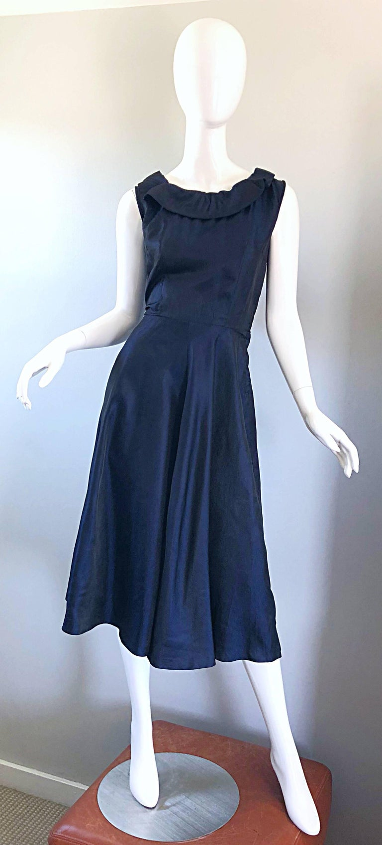 fc89008f65e Beautiful 1950s navy blue silk dress! Features a fitted bodice with chic  ties at top