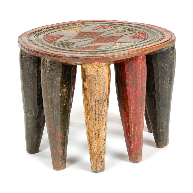 A vintage and intricately carved ten legged stool from the Nupe tribe of Nigeria.