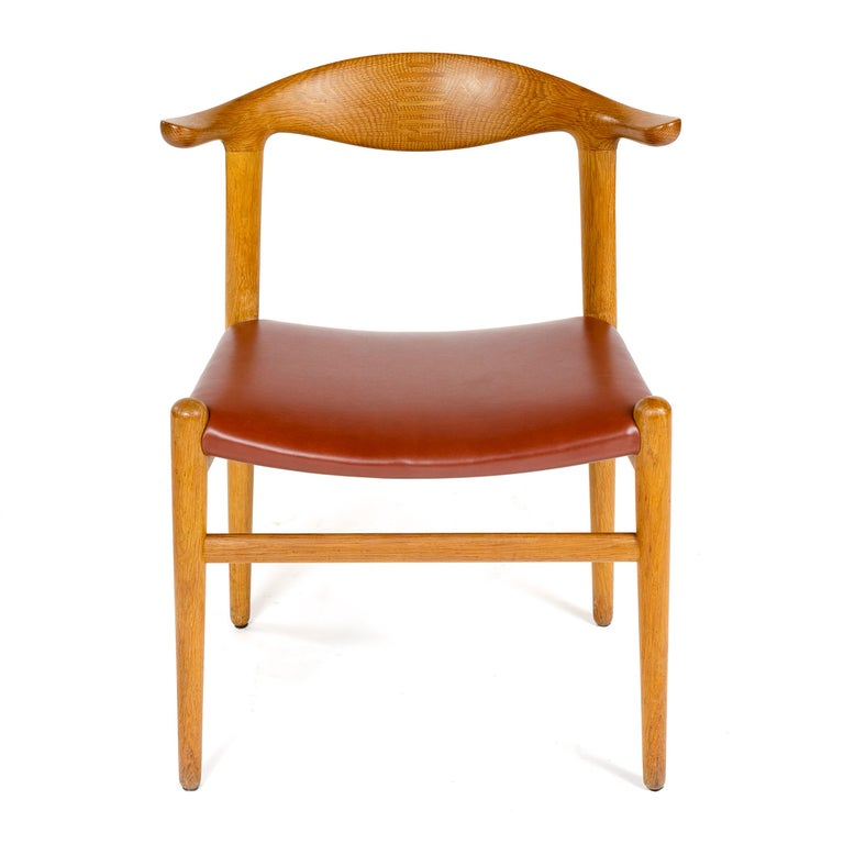 A rare oak 'cow horn' dining chair with a splined backrest and an upholstered leather seat.