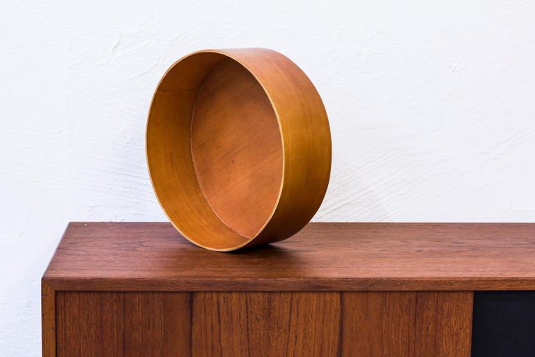 Swedish Oregon pine bowl designed by Torsten Johansson. Produced during the 1950s by his own company Formträ AB. Very good condition with light wear and patina. Rare large size.