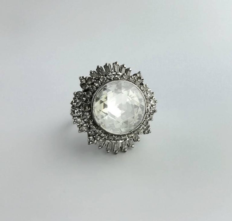 Rare and Collectable! This Antique Rose cut Diamond is clean and white. The mounting is an Indian work with round and baguette cut diamond. The diameter of the central diamond is approximately 15.00 millimeters. Circa 1950.