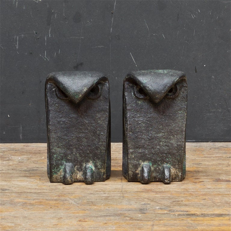 Pair of heavy welded metal abstract bird sculptures. Some remnants of greenish and gold patina on steel. Made in Japan. Cleaned and waxed.   Each bird is 6 inches High and weighs 3.35 lbs.