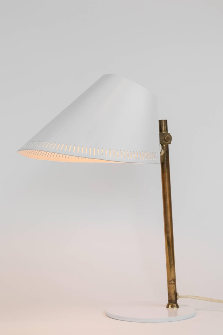 1950s Paavo Tynell 9227 table lamp for Idman. An increasingly rare design from a highly collectible Finnish design icon executed in brass and white aluminum and metal. Retain original Idman manufacturer's stamp.  Not UL listed, but recommended UL