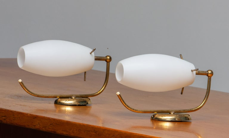 Beautiful set of two brass wall lights / lamps from the 1950s opaline vases made by Stilnovo Lainate Milan, Italy.
