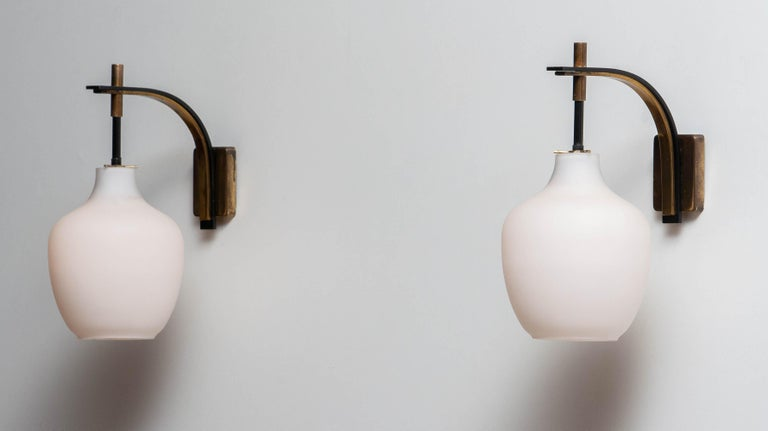 Beautiful set of two typical Italian wall lights made in the 1950s both with the original frosted glass vases. Each fixtures has got a fitting for screw bulb size E14 /17 and suits 110 as well as 230 Volts. Technically 100%. (rewired).