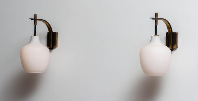 1950s Pair Italian Black and Brass, Frosted Glass and Wall Lights by Stilnovo 1