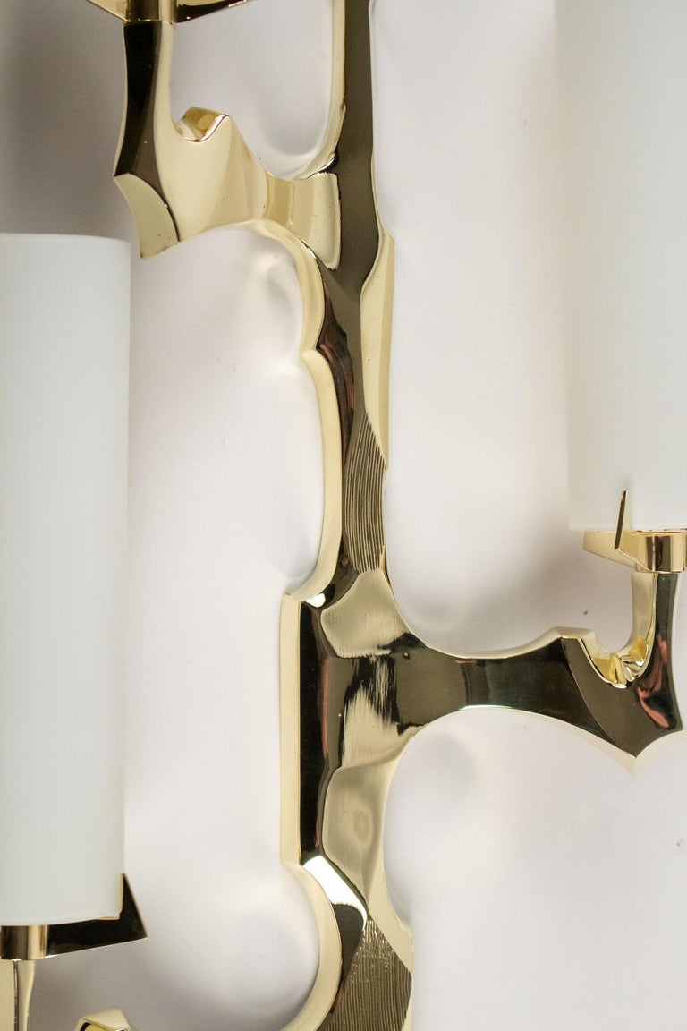 1950s Pair of Arlus Bronze Sconces The sconces are made of gilded bronze and feature three bulbs with cylindrical opalin glass shades.  The pair is composed with to symmetrical sconces. Manufactured by Arlus, 1950s, France.