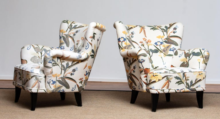 Set of two beautiful 1940s-1950s lounge / club chairs reupholstered, in a later period, with the typical floral print fabric designed by Josef Frank. The chairs are designed by Ilmari Lappalainen for Asko in Finland The overall condition is good.