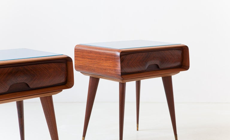 Pair of elegant and modern bedside tables, manufactured in Italy during the 1950s