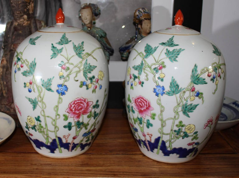 1950s pair of oriental urns with flower decorations.
