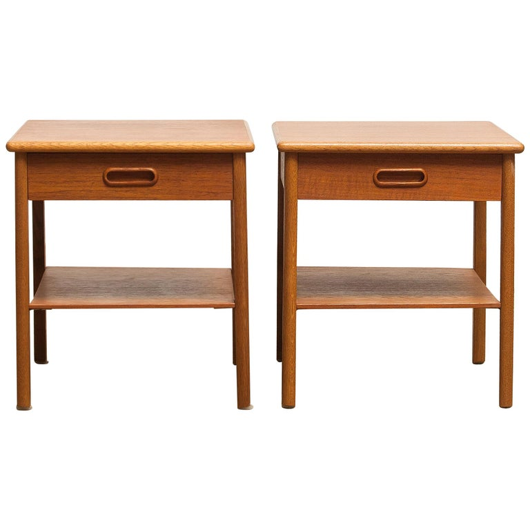 Beautiful pair of bedside tables from Sweden. These tables are made of teak and they have a drawer. They are in very nice condition. Period 1950s. Dimensions: H 39 cm, W 36 cm, D 48 cm.