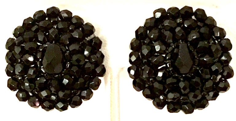 1950'S Pair Of Silver & Jet Black Brilliant cut and faceted art glass bead clip style earrings. Mounted on silver tone metal.