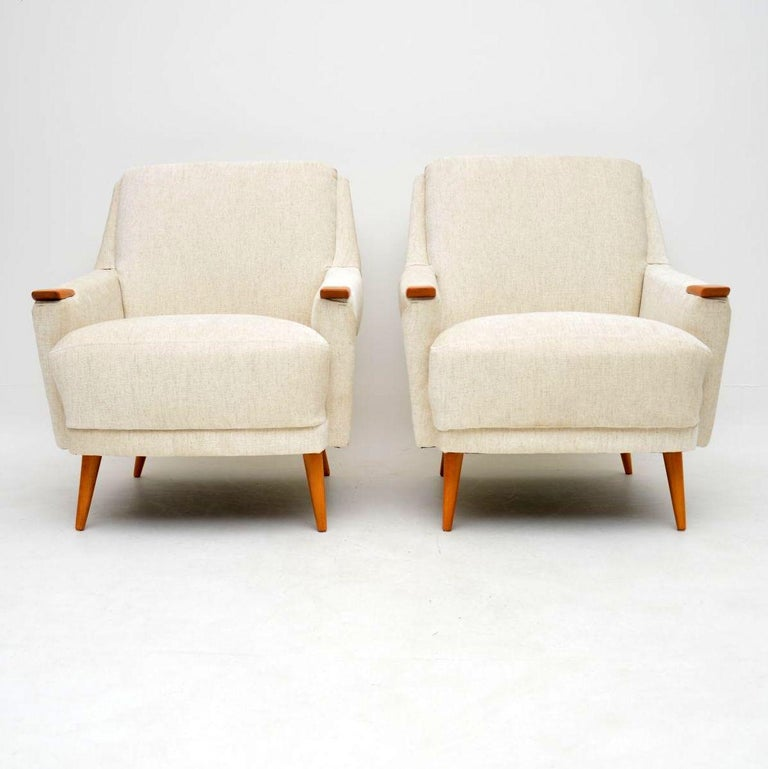A spectacular pair of vintage Danish armchairs, these date from the 1950s-1960s. They are of amazing quality, are very comfortable and in absolutely superb condition. We have had the arms and legs stripped and re-polished to a very high standard,