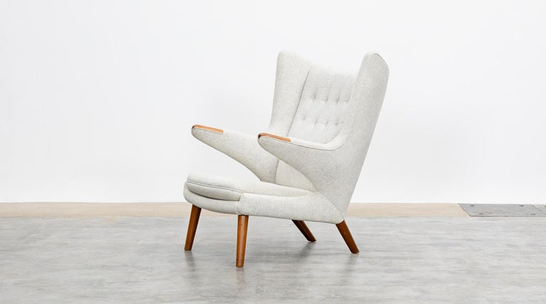 Papa Bear chair by Hans Wegner manufactured by A.P. Stolen, Denmark, 1951  Wonderful original Papa Bear chair designed by Hans Wegner. This ingenious piece comes in perfect condition, upholstery with high-quality woolen fabric in light grey. The