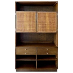 1950s Paul McCobb Walnut Bookcase with Caned Doors and Brass Hardware
