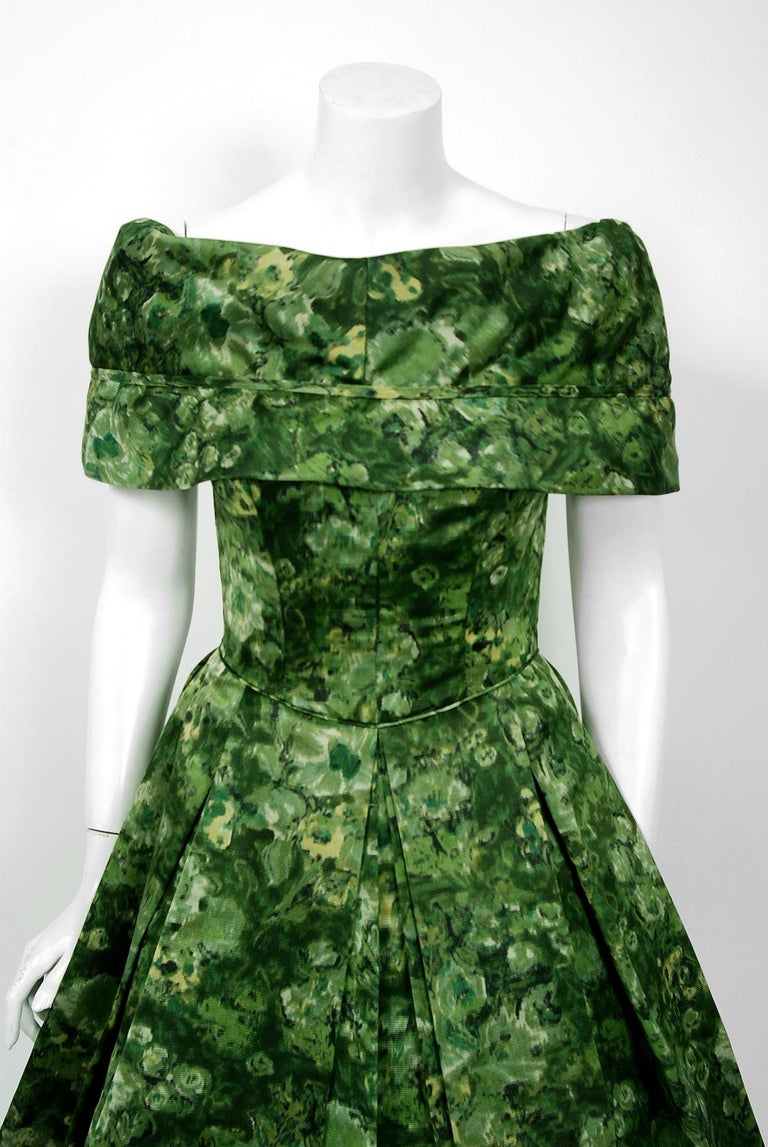 An amazing and highly stylized 1950's floral silk-faille dress by the famous American designer Peggy Hunt. Starting in the 1930's through the early 1960's, she was immensely successful with her specialized cocktail and evening looks. Her garments