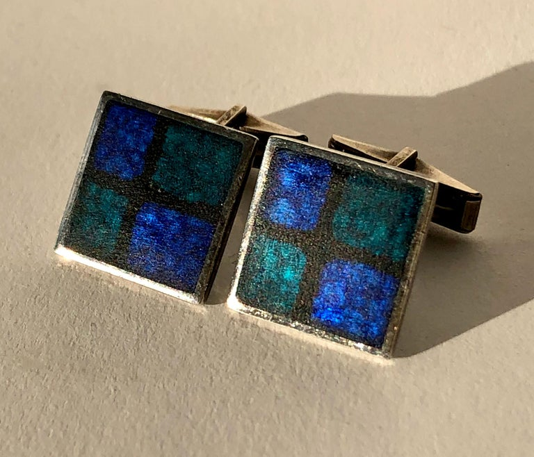 Pair of German modernist silver and enamel cufflinks designed by Perli, circa 1950s.  Dark blue grid cufflinks have counter enamel in black.  The measure about .75
