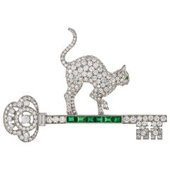 1950s Platinum, Diamond and Emerald Cat and Key Brooch