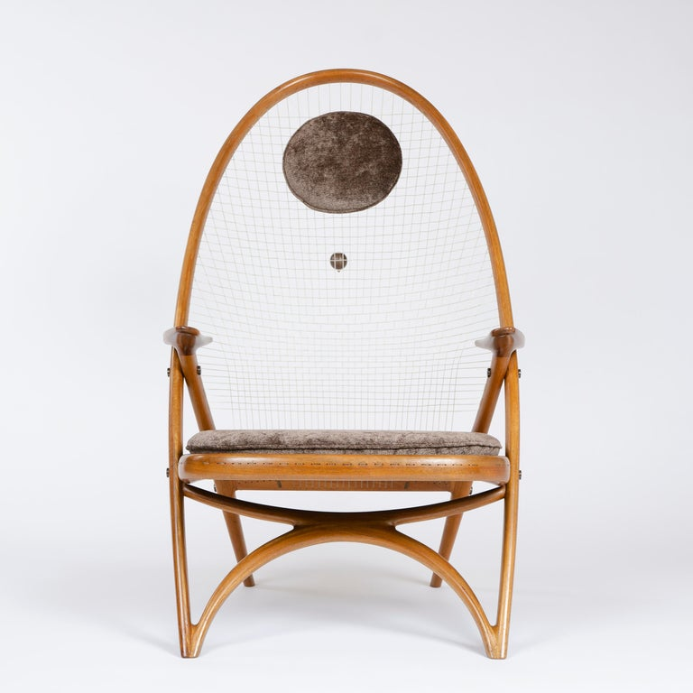 A rare easy chair designed by the architect Helge Vestergaard Jensen and executed by the cabinet-maker Peder Pedersen for the exhibition in 1955. The Racquet chair chair has distinct reminiscences of the Windsor chair though the modern lamination
