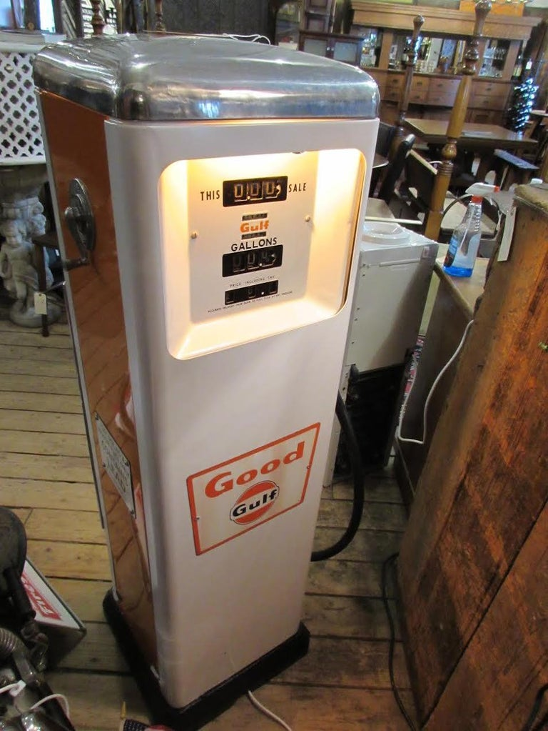 1950s, rare Gulf Co. made two sided gas pump. Newly painted panels, with original signage. Actual pumps removed and rewired for lighting from inside.  Made by Gulf period late 1950s  All steel consruction.
