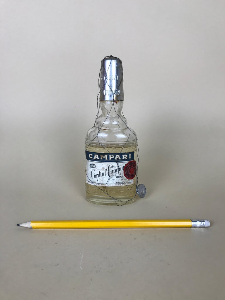 This rare vintage Cordial Campari glass flask is totally iconic! Both for its limited edition as bottle both because this Raspberry flavoured liqueur was produced only in the spring/summer season.  The bottle is full with original liquor with