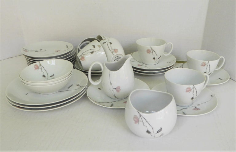 A 1950s Continental China porcelaincoffee breakfast service of 36 pieces from Rosenthal, the German porcelain maker. Designed by Raymond Loewy and in production from 1956 through 1964. Mid-Century Modern depiction of flowering Quince tree branches