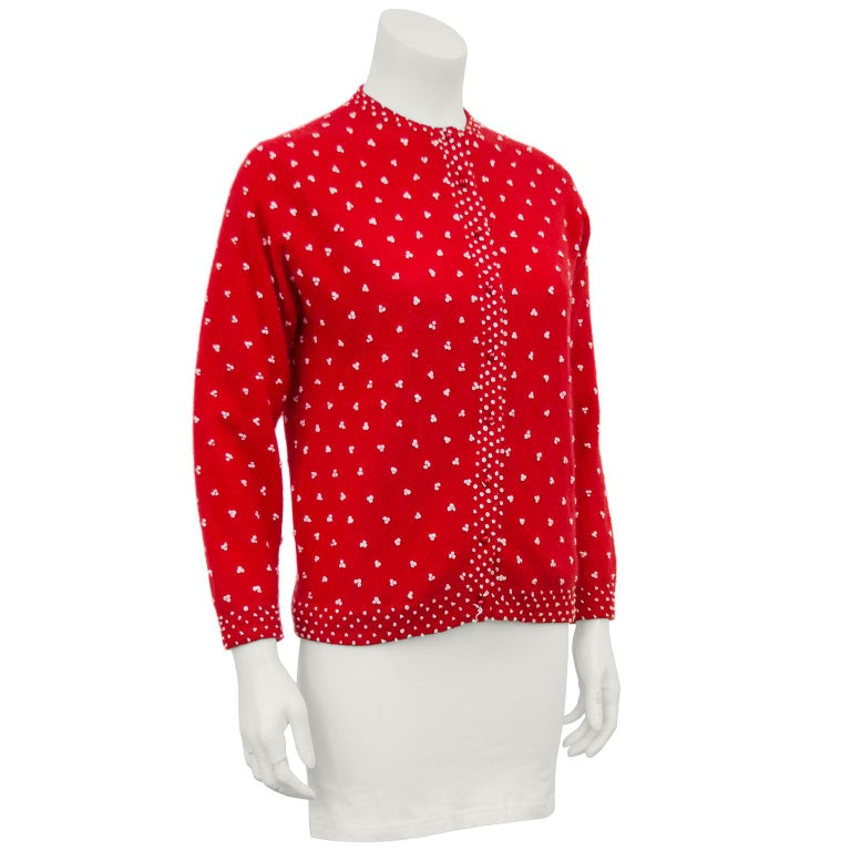 Chic red knit 1950's cardigan with beige French knot details. So often these cardigans are sequinned or embroidered, or both. This version has all the look but can be worn day or night. Fresh clean condition, fully lined and ready to wear. Feels