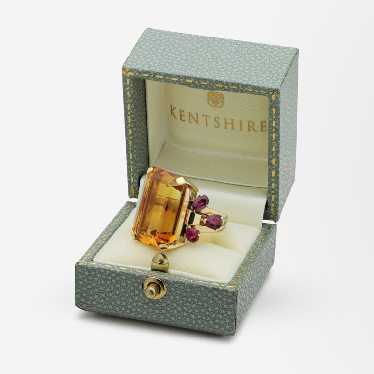 An impressive cocktail ring from the 1950s by famed American jeweller, Tiffany and Company. This ring centres on a large octagonal cut, honey coloured citrine that has three pear shaped rubies on each shoulder. The ring which has been handcrafted in