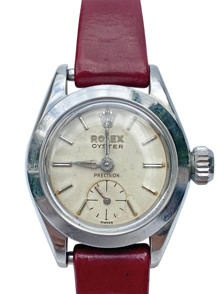 Vintage Rolex Oyster Precision stainless steel watch circa 1950. Manual wind movement caliber 10 1/2 is in full working condition. Case 30mm with original crystal and original crown. Untouched dial with a nice patina. Aftermarket genuine leather