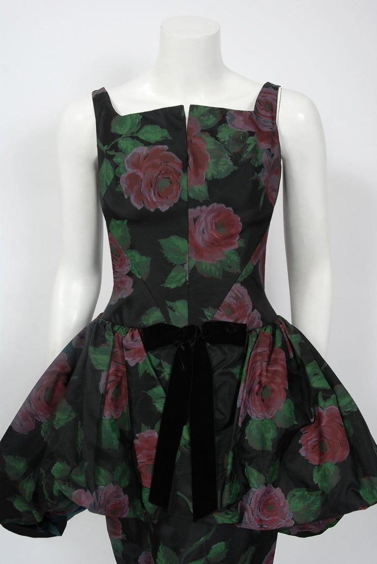 In this gorgeous 1950's rose-print cocktail dress, the detailed construction and meticulous attention to detail are comparable to what you will find in modern couture. The garment is fashioned in mid-weight silk taffeta with the prettiest large