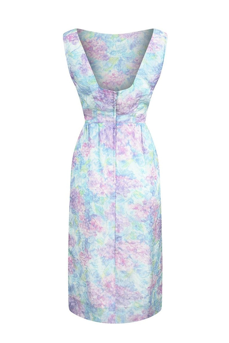 This lovely 1950s pastel toned wiggle dress is labelled Saks Fifth Avenue and is in wonderful vintage condition. This piece is beautifully cut to suit an hourglass figure, with a fitted bodice and skilful tailoring to ensure the fabric fits