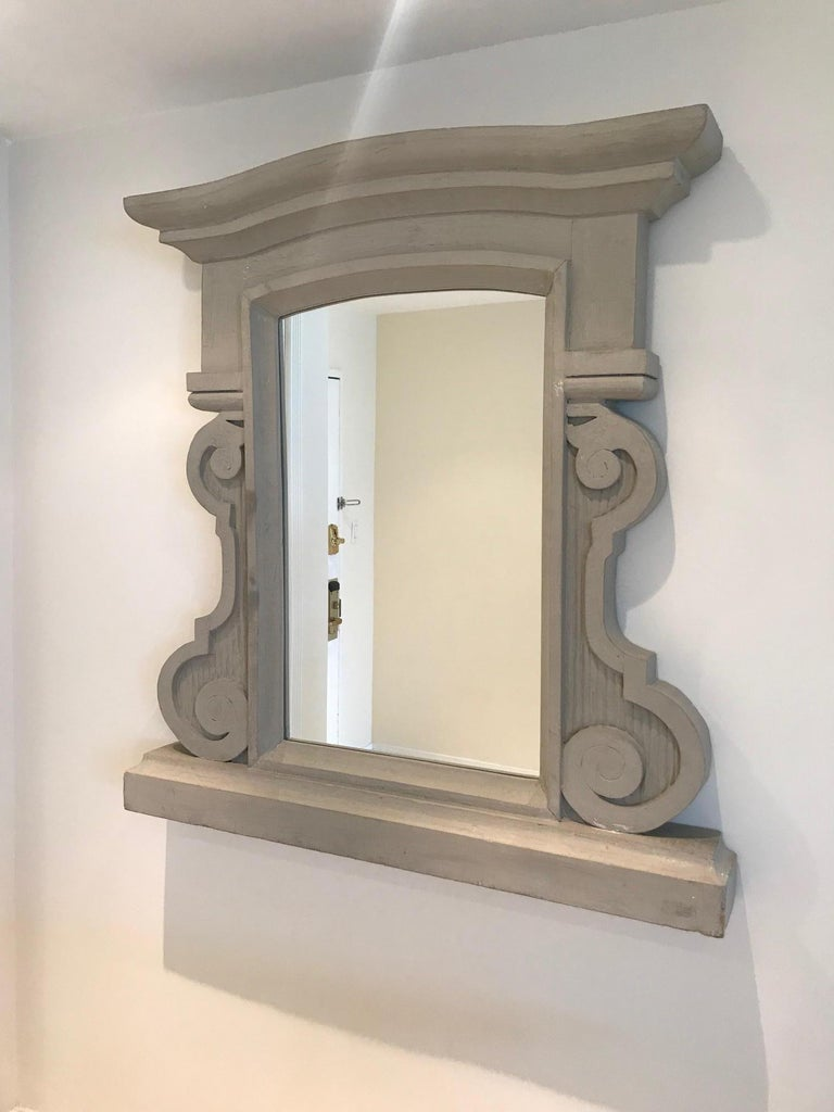 Hollywood Regency 1950's Scrolled Wood Mirror Hand Carved with Distressed Greige Finish, France For Sale