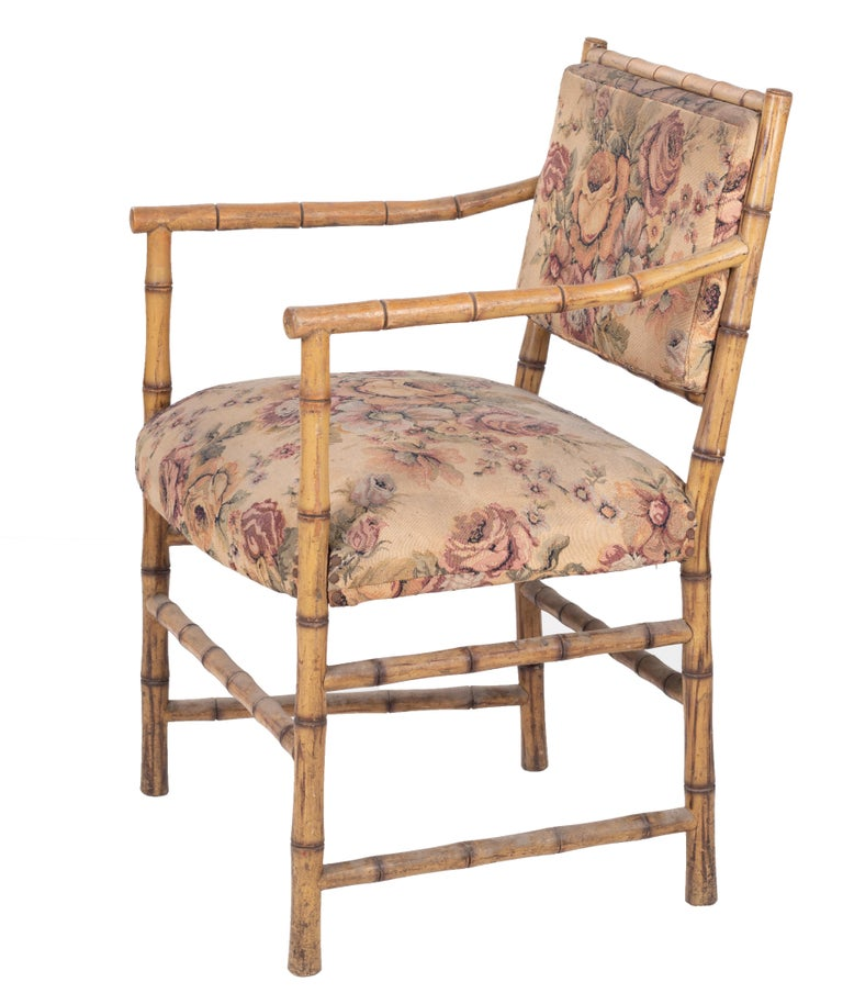 1950s set of eight English bamboo upholstered armchairs.