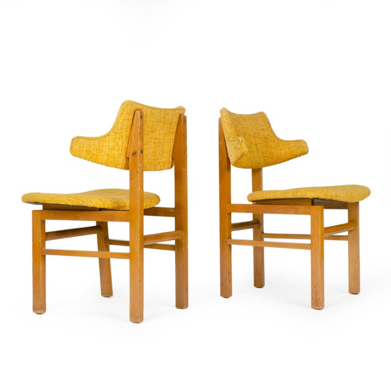 A set of dining chairs with exposed walnut frames supporting floating laminated seats and sculptural back rests, both covered in vintage upholstery. Designed in 1953 as a component of the newly introduced Career Group, produced through 1957. Listing
