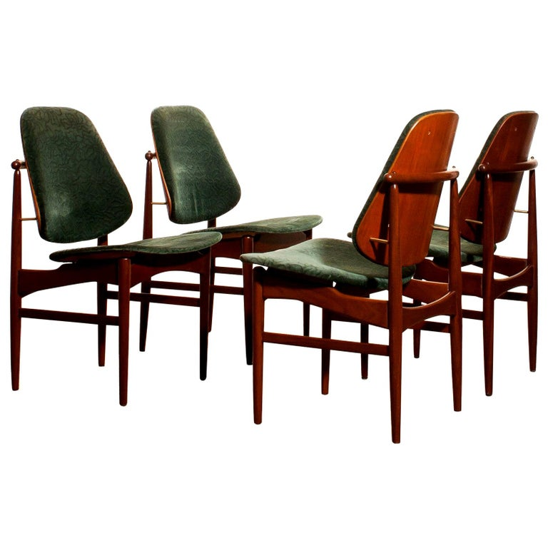 Beautiful set of four Arne Vodder design armchairs made by France & Daverkosen, Denmark. The (original) fabric needs to be replaced! These chairs sit extremely comfortable and are beautifully finished with beautiful bronze details. The teak