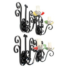 1950s Set of Four Vallauris Like Ceramic and Wrought Iron Sconces