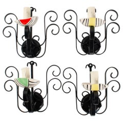 1950 Set of four wall lights in ceramic and wrought iron Ecole de Vallauris.
