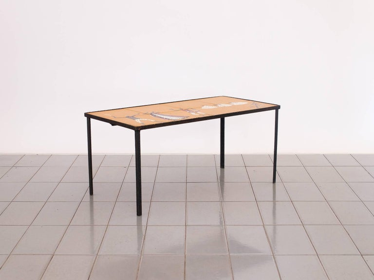 Small iron auxiliary table produced by Casa Hollanda in Recife, Brazil, 1958. The top is composed of eight ceramic tiles with hand-painted raised enamel. Signature / artist can't be identified.
