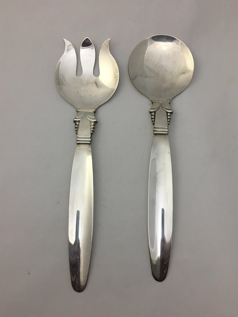 Georg Jensen style silver plate on copper modern serving fork and spoon, circa 1950. Signed on back, Original by A.L., silver/copper. Very good condition.
