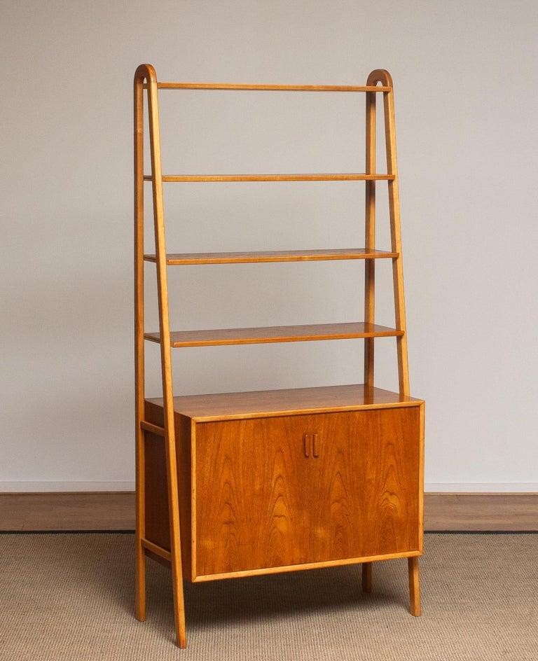 Swedish 1950s Slim Shelfs / Bookcase / Sideboard in Teak and Beech by Brantorps, Sweden For Sale