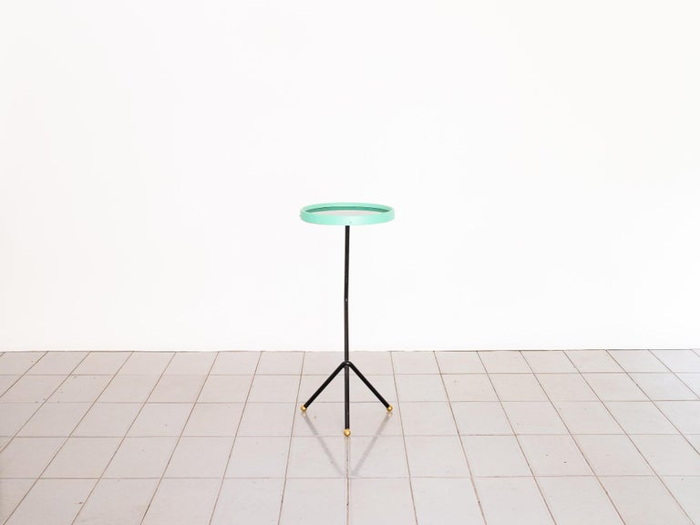 Beautiful table with black glass top. Perfect for using in the sofa.