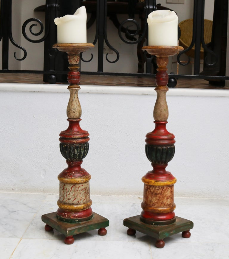 1950s Spanish pair of wooden painted candle pricket sticks.