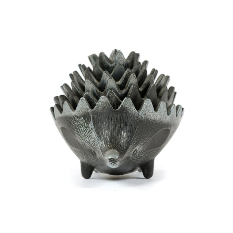 A set of (6) pewter stacking ashtrays in the form of a hedgehog, in the style of Walter Bosse.