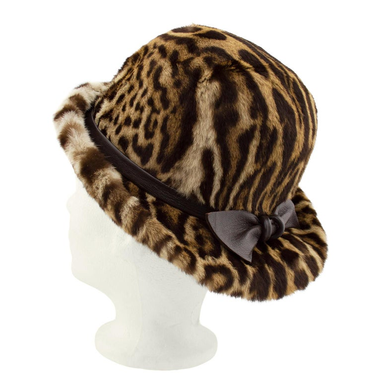 Beautiful 1950s stencil faux leopard print bowler style hat with brown leather bow. Brown silk lining. Made in Toronto, Canada. Excellent vintage condition. Fits small. Can be worn brim up or down.