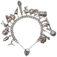 1950s Sterling Silver English Padlocked Charm Bracelet with Seventeen Charms