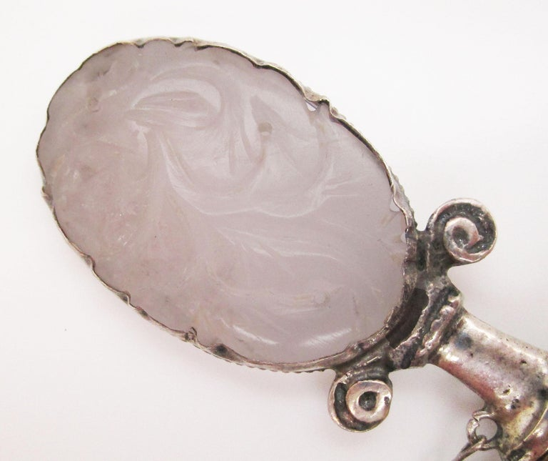 This sterling silver brooch brings together an epic combination of carved rose quartz and onyx to create an incredible piece of wearable art unlike anything you have seen! The sterling silver has been fashioned into the shape of a miniature blade,