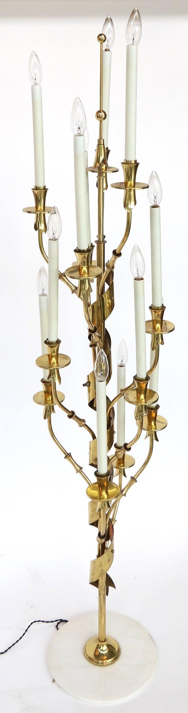 1950s Stilnovo brass candelabra floor lamp with nine-light and marble base.
