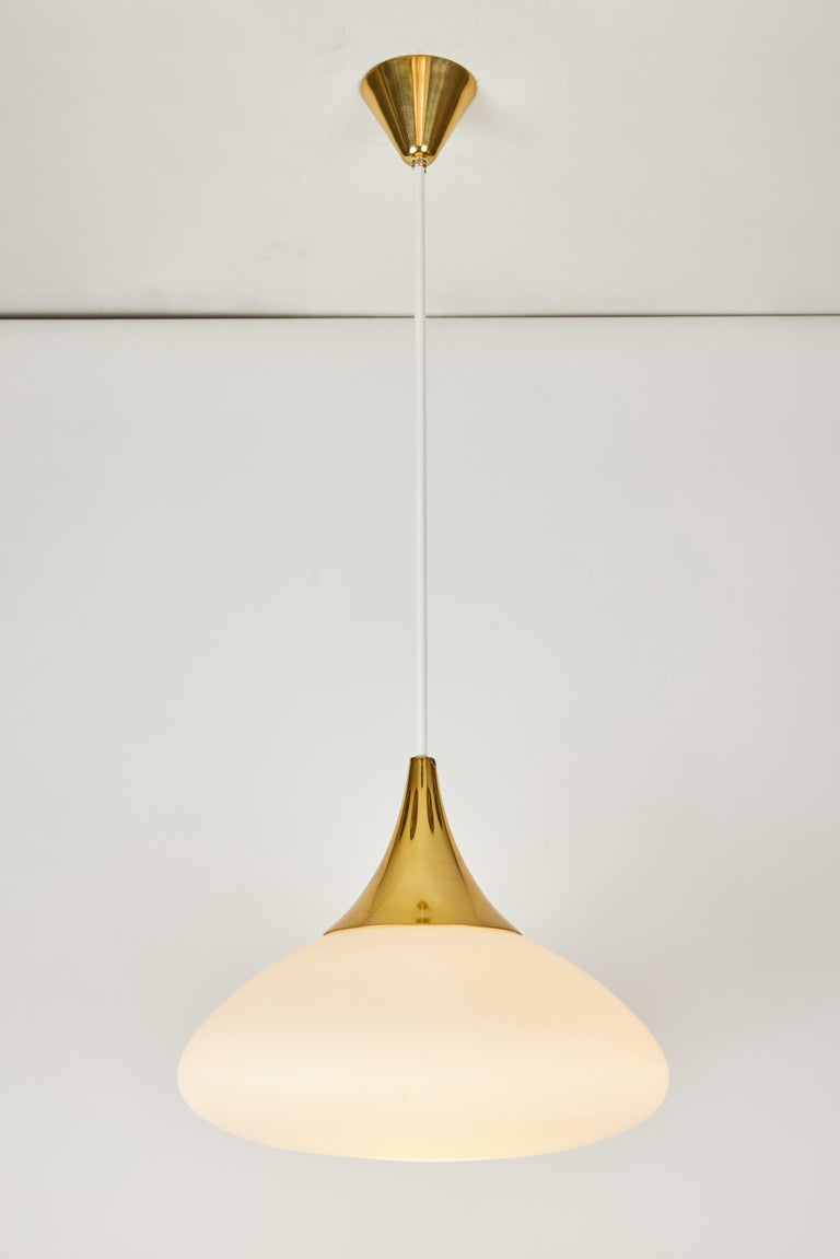 1950s Stilnovo glass and brass pendant. A quintessentially 1950s Italian design executed in matte finish opaline glass, painted metal and brass with original architectural ceiling canopy. A highly functional light sculpture of attractive scale and